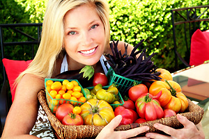 Kelly Emberg Holding a basket of Vegetables